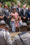 Family members are comforted as the casket of slain State Senator Clementa Pinckney is carried into the State House by Police honor guards June 24, 2015 in Columbia, South Carolina. Pinckney is one of the nine people killed in last weeks Charleston church massacre.