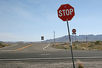 Two stop signs on a highway in Arizona