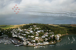 © Licensed to London News Pictures. 29/08/2014. Port of Dartmouth UK The RAF Red Arrows and RAF Typhoon entertain the crowds at the Port of Dartmouth Royal Regatta, Devon the event runs 28-30 August . Photo credit : Jason Bryant/LNP