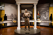 A statue of former Grambling State University football head coach Eddie Robinson stands in the entrance of the Eddie G. Robinson Museum in Grambling, Louisiana on October 23, 2013.  (Cooper Neill for The New York Times)
