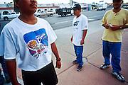 jku040703024 - PHOENIX, ARIZONA, USA: Day laborers at the corner of Thomas Rd and 36th Street in Phoenix wait for work at the corner, August 2001. Many of the day laborers who look for work on valley street corners are undocumented immigrants.  PHOTO © JACK KURTZ    LABOR   IMMIGRANTS   ECONOMY