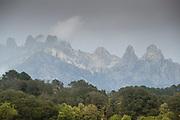View of mountains under overcast sky, Aiguilles de Bavella, Quenza, Corsica, France