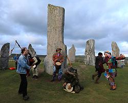 Celebrating the summer solstice at the 5000 year old Callanish Standing Stones, Isle of Lewis ........ (c) Stephen Lawson   Edinburgh Elite media