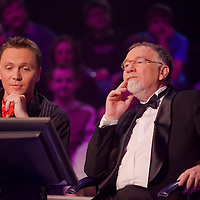 Gabor Gonczi (L) and Istvan Vago (R) host a special edition of the quiz show Who Wants to Be a Millionaire.