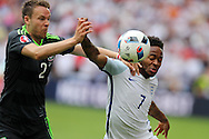 Raheem Sterling of England ® is challenged by Chris Gunter of Wales.  Euro 2016, group B , England v Wales at Stade Bollaert -Delelis  in Lens, France on Thursday 16th June 2016, pic by  Andrew Orchard, Andrew Orchard sports photography.