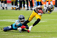 NASHVILLE, TN - OCTOBER 25:  Diontae Johnson #18 of the Pittsburgh Steelers is tackled in the second half after catching a pass by Malcolm Butler #21 of the Tennessee Titans at Nissan Stadium on October 25, 2020 in Nashville, Tennessee.  The Steelers defeated the Titans 27-24.  (Photo by Wesley Hitt/Getty Images) *** Local Caption *** Diontae Johnson; Malcolm Butler