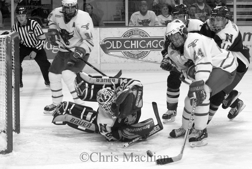 James Chalmers shot gets pushed wide by NMU goalie Dan Ragusett during Friday night's game.<br /> photo by chris