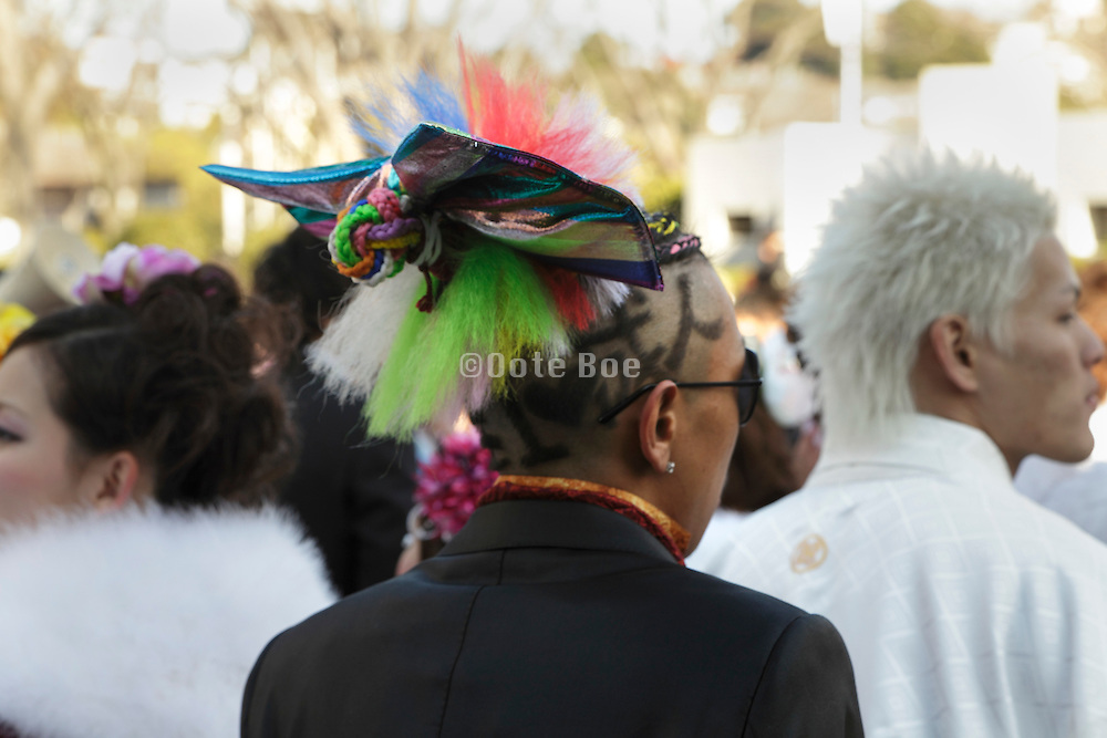 young adult male with elaborate hair style during his Coming of Age festival, Japan