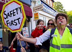 © licensed to London News Pictures. London, UK  05/06/11. Parent Celia Robertson helped lead the march. Early this morning 400 parents and children from Alleyn's, Dulwich Hamlet and James Allen's Preparatory School, marched through Dulwich to protest about government plans to remove their lollipop men. Children made signs, blew whistles and shouted 'save our lollipop'.  Please see special instructions for usage rates. Photo credit should read Mary Stamm-Clarke/LNP