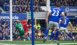 28.10.2012, Goodison Park, Liverpool, ENG, Premier League, FC Everton vs FC Liverpool, 9. Runde, im Bild Liverpool's Luis Alberto Suarez Diaz fires the ball across the goal for Everton's Leighton Baines to score an own goal during the English Premier League 9th round match between Everton FC and Liverpool FC at the Goodison Park, Liverpool, Great Britain on 2012/10/28. EXPA Pictures © 2012, PhotoCredit: EXPA/ Propagandaphoto/ David Rawcliffe..***** ATTENTION - OUT OF ENG, GBR, UK *****