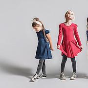A studio shoot for a junior fashion brand.