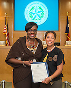 Wanda Adams, left, poses for a photograph with Dr. Reagan Flowers, right, during the Board of Trustees meeting, June 11, 2015.