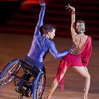 Maxim Sedakov in wheelchair and Svetlana Kukushkina from Russia perform their exhibition dance during the World Latin-american Championships held in Maribor, Slovenia