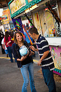 A couple eats cotton candy at the South Carolina Coastal Fair in Charleston, SC.