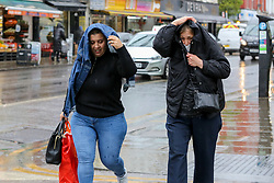 © Licensed to London News Pictures. 05/05/2021. London, UK. Women are caught in heavy rainfall in north London. More rain and sleet is forecasted for the South East this week. Photo credit: Dinendra Haria/LNP