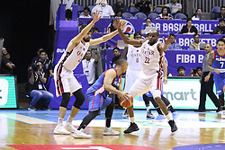 September 17, 2018 - Quezon City, NCR, Philippines - Suliman Abdi Khalid (22, White) and Nasser Khaifa Al-Rayes (42, White) of Qatar collapse their defense over Paul Lee Dalistan (Blue) of the Philippines. (Credit Image: © Dennis Jerome S. Acosta/Pacific Press via ZUMA Wire)