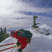 Mount Baker Ski Area, Washington.An out-of-bounds skier on a ridge in front of Mount Baker.
