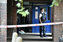 © Licensed to London News Pictures. 17/08/2018. London, UK. Police at a property where Gary Amer (63) was stabbed to death at Laysdown House on Madron Street in Southwark, South London. 67 year old William Treadwell has been charged with his murder. Photo credit: Ben Cawthra/LNP