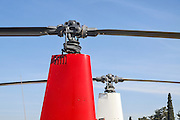 closeup of a helicopter rotor head and blades