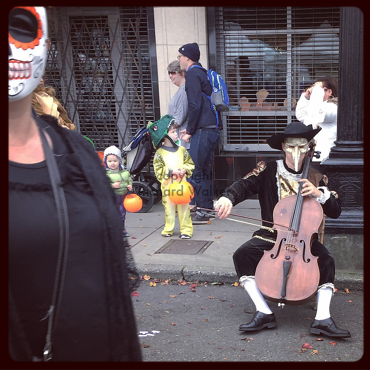 2016 October 30 - A man plays a cello on the street during Halloween festival in the Junction in West Seattle, WA, USA. Taken/edited with Instagram App for iPhone. By Richard Walker
