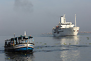 Thursday 14th August 2014: A large cruise ship passes the Fort Kochi - Vypin passenger ferry.