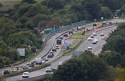 © Licensed to London News Pictures. 02/09/2015. Shoreham, UK. Vehicles on the A27 road pass near the site of the crashed Hawker Hunter fighter jet. The aircraft crashed while performing at the Shoreham air show on August 22, 2015 killing 11 people on the ground. As an inquest into the deaths opened today in nearby Horsham, the name of the last of the victims Graham Mallinson was released.  Photo credit: Peter Macdiarmid/LNP
