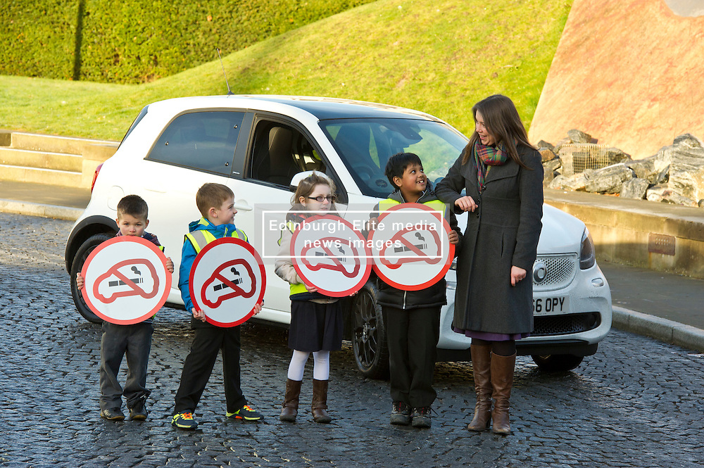 Pictured: Aileen Campbell, Amber McEwan (9), Sevi Dick (6) ( blue jacket), Ahnaf Taluhder (7) and Christopher Pavlov (4)<br /> <br /> Today Minister for Public Health, Aileen Campbell,  met pupils from Holyrood Primary School to mark the day smoking in cars with children becomes illegal across Scotland<br /> <br /> Ger Harley   EEm 5 December 2016