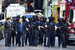 Armed police on St Thomas Street, London, near the scene of last night's terrorist incident at Borough Market.