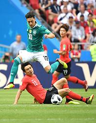 June 27, 2018  - Kazan, Russia - MESUT OEZIL (top) of Germany breaks through with the ball during the 2018 FIFA World Cup Group F match between Germany and South Korea in Kazan, Russia. (Credit Image: © Li Ga/Xinhua via ZUMA Wire)
