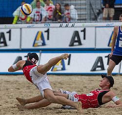 31-07-2014 AUT: FIVB Grandslam Volleybal, Klagenfurt<br /> Austrian player Lorenz Petutschnig and Tobias Winter in action during the game Stiekema/Varenhorst (NED) - Petutschnig/Winter (AUT)<br /> ***NETHERLANDS ONLY***