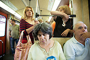 Interior of passengers on a Metro train. Athens is the capital and largest city of Greece. It dominates the Attica periphery and is one of the world's oldest cities, as its recorded history spans around 3,400 years. Classical Athens was a powerful city-state. A centre for the arts, learning and philosophy.