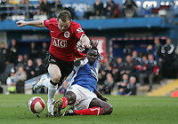 Photo: Lee Earle.<br /> Portsmouth v Manchester United. The Barclays Premiership. 07/04/2007.Portsmouth's Linvoy Primus (R) slides in on Wayne Rooney.