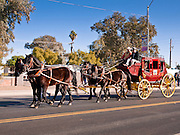 28 JANUARY 2012 - BUCKEYE, AZ:    The Wells Fargo Bank stagecoach in the Buckeye Days parade. The Buckeye Days parade went through downtown Buckeye, AZ, an agricultural community about 45 miles west of Phoenix. The parade was one the first events to mark Arizona's centennial celebration. Arizona was admitted to the United States on Feb 14, 1912, making it the 48th state in the union. The state celebrates its 100th birthday with a series of events on Feb. 14, 2012.     PHOTO BY JACK KURTZ