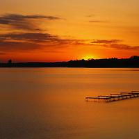 """Grand Traverse Bay Sunrise""<br /> <br /> Gorgeous golden sunrise over Grand Traverse Bay in Traverse City, Michigan."