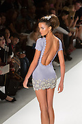 Backless mini-dress with jewel clusters at the bottom. By Zang Toi, shown at his Spring 20132 Fashion Week show in New York.