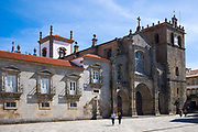Tourists at 12th Century Se Gothic cathedral in Lamego, Portugal