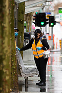 Cleaners are seen sanitizing surfaces in the rain in the city during COVID-19 in Melbourne, Australia. Victoria has recorded 14 COVID related deaths including a 20 year old, marking the youngest to die from Coronavirus in Australia, and an additional 372 new cases overnight. (Photo by Dave Hewison/Speed Media)