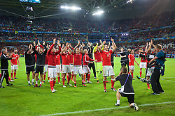 5LILLE, FRANCE - Friday, July 1, 2016: Wales' Gareth Bale leads the celebrations as the players salute the supporters after a 3-1 victory over Belgium during the UEFA Euro 2016 Championship Quarter-Final match at the Stade Pierre Mauroy. (Pic by Paul Greenwood/Propaganda)