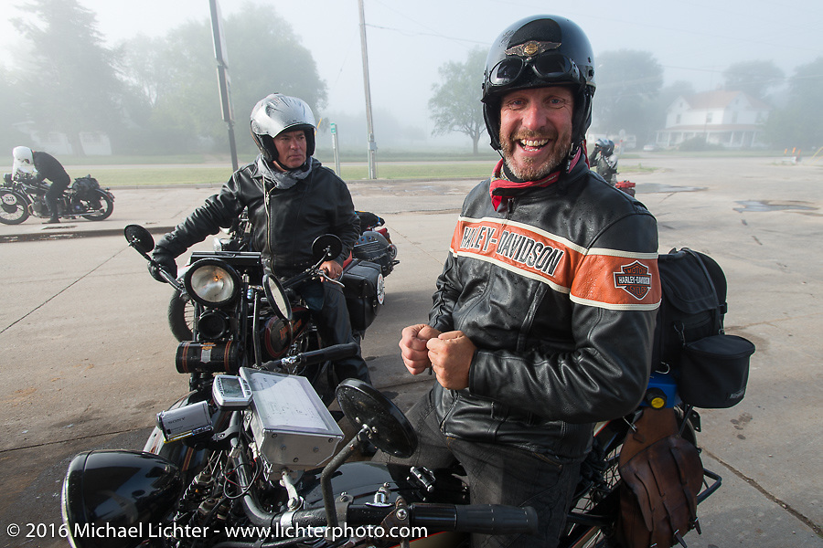 """Robert Gustavsson or """"Big Swede"""" as he is fondly known, stopped for gas on his 1931 Harley-Davidson VL during Stage 8 of the Motorcycle Cannonball Cross-Country Endurance Run, which on this day ran from Junction City, KS to Burlington, CO., USA. Saturday, September 13, 2014.  Photography ©2014 Michael Lichter."""