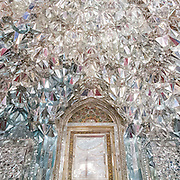Mirrored muqarnas (decorative corbel) in the Hall of Diamonds (Talar-e Almas) in the Golestan Palace, Tehran. It is called Hall of Diamonds because of the exceptional mirror work inside the building.  The construction of this hall dates to the time of Fath Ali Shah (circa1806). Tehran, Iran
