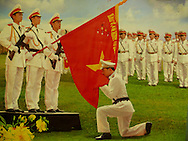 Military propaganda's poster representing a soldier kissing the national flag while he stands on his knees. Vietnam, Asia
