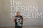 Artist Peter Kennard with a poster copy of his work which was on show at the Design Museum, London, Unted Kingdom, August 02 2018. He decided to pull his work on show in the permanent collection at the Design Museum in protest against the museums involvement with the arms industry. The Design Museum hosted an event by Leonardo, the ninth biggest arms company in the world and around 40 artists showing work in the exhibition Nope to Hope demanded their work pulled in protest. A group of artist and representatives collected the work.