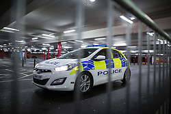 © Licensed to London News Pictures . 27/11/2015 . Salford , UK . A police car pulls up beside the queue for Black Friday reductions , at a branch of Tesco in Pendleton , Salford , this morning (Friday 27th November) . Last year (2014) scuffles and fights were reported amongst queuing bargain-hunters . Photo credit: Joel Goodman/LNP