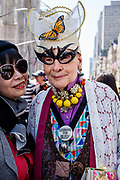 """New York, NY - April 16, 2017.  A woman in a elaborate costume including bat-woman glasses wears a pin reading """"Lesbians for Bush."""""""