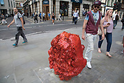 Sculpture in the City on July 17th 2017 in the City of London, England, United Kingdom. Each year, the critically acclaimed Sculpture in the City returns to the Square Mile with contemporary art works from internationally renowned artists in a public exhibition of artworks  open to everyone to come and interact with and enjoy. Untitled x3 by Bosco Sodi 2012-15.