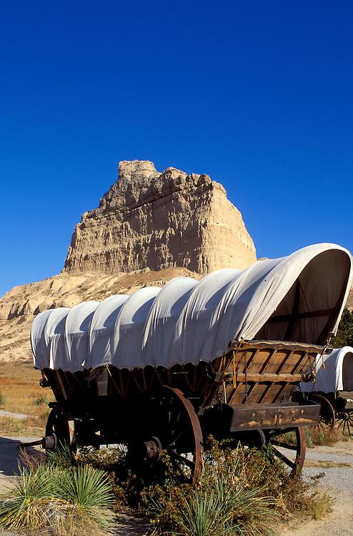 Conestoga wagons under Eagle Rock on the Oregon Trail, Scotts Bluff National Monument, Nebraska USA
