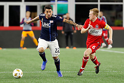 September 22, 2018 - Foxborough, MA, U.S. - FOXBOROUGH, MA - SEPTEMBER 22: New England Revolution forward Guillermo Hauche (22) fends off Chicago Fire midfielder Dax McCarty (6) during a match between the New England Revolution and the Chicago Fire on September 22, 2018, at Gillette Stadium in Foxborough, Massachusetts. The teams played to a 2-2 draw. (Photo by Fred Kfoury III/Icon Sportswire) (Credit Image: © Fred Kfoury Iii/Icon SMI via ZUMA Press)