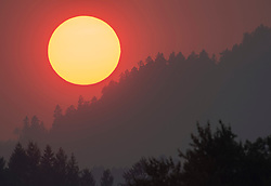 August 2, 2017 - Roseburg, OREGON, U.S - Smoke from nearby wildfires paints the sky orange as the sun sets as seen from near Roseburg in western Oregon. A heatwave has pushed the temperatures well above 100 degrees in many spots across the Pacific Northwest. The fire danger is extreme in many areas. (Credit Image: © Robin Loznak via ZUMA Wire)