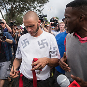 A lone white supremacist walks through the crowd as protestors gather in the staging site prior to a Richard Spencer speech at the Phillips Center for the Performing Arts on the University of Florida campus in Gainesville, Florida on Thursday, October 18, 2017. (Alex Menendez)