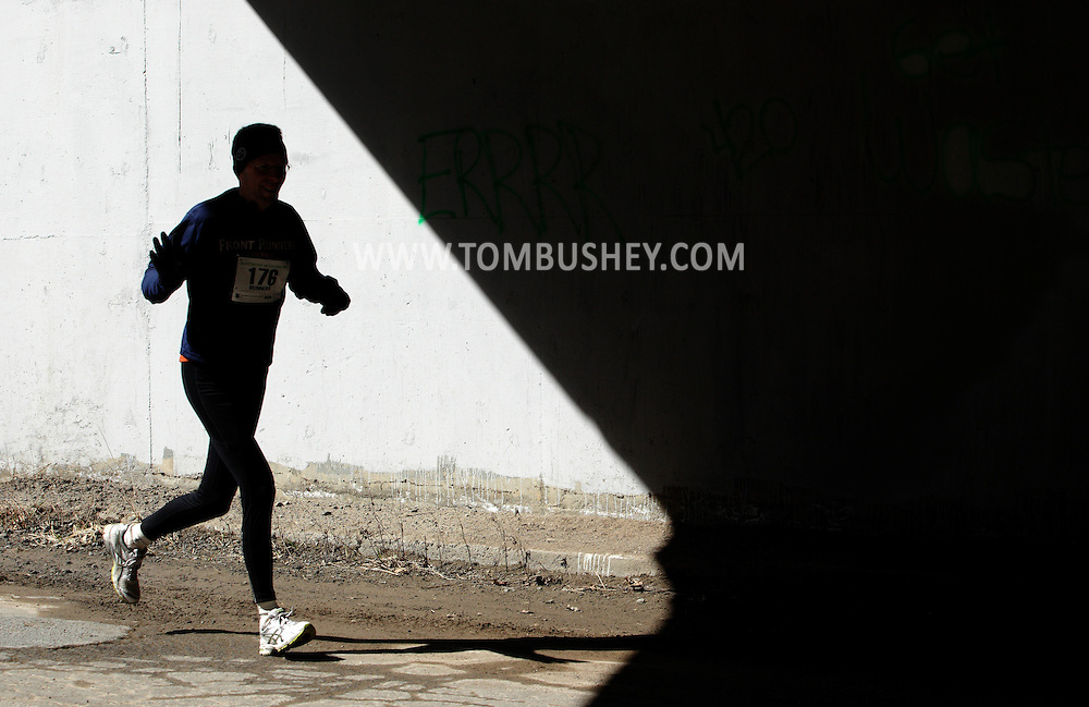 Mamakating, New York -  A runner enters a tunnel during the Wurtsboro Mountain 30K road race on March 26, 2011.